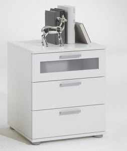 A bedside cabinet in white gives a charming look to the bed and the bedroom