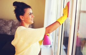 woman cleaning windows 300x193 - Housekeeping Tips And Tricks