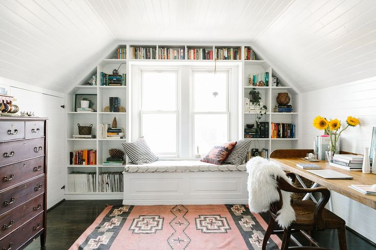 Attic office space with great shelving around window - 6 potential home office spots that you might not have considered