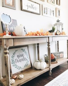 a bright fall or Thanksgiving console table with colorful fall leaves fabric or plastic pumpkins an 240x300 - How To Decorate Your Home & Hallway In Autumn & Fall Season